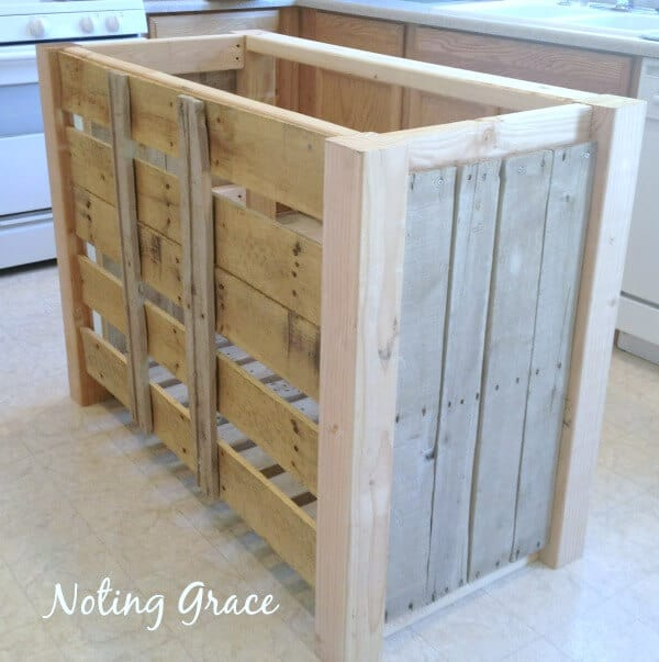 When we were living in a rental, our home was lacking a counter space, so we built a DIY Pallet Kitchen Island for less than $50.