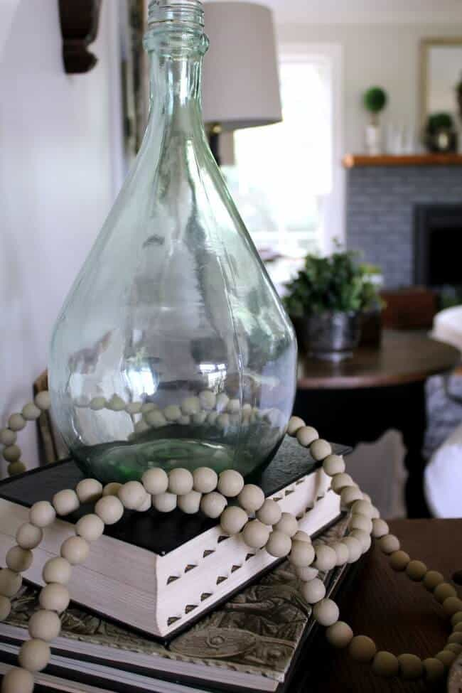 DIY Demijohn: How I took a garage sale find and flipped it into a 25 cent demijohn - how to decorate with glass.