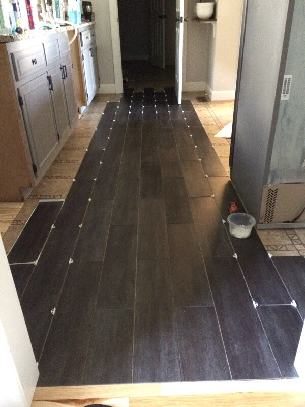 Our DIY Flooring only took 3 days and $400 to completely transform our kitchen with groutable Luxury Vinyl Tile.