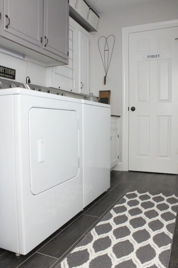 These homeowners transformed their dated laundry room into a gorgeous, vintage inspired laundry room! I love the drying rack!
