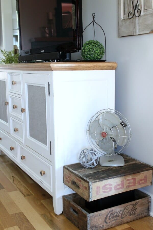 Easy Entertainment Center Makeover: I love how this blogger took a dated entertainment center that no longer matched her decor and updated it into a stunner!