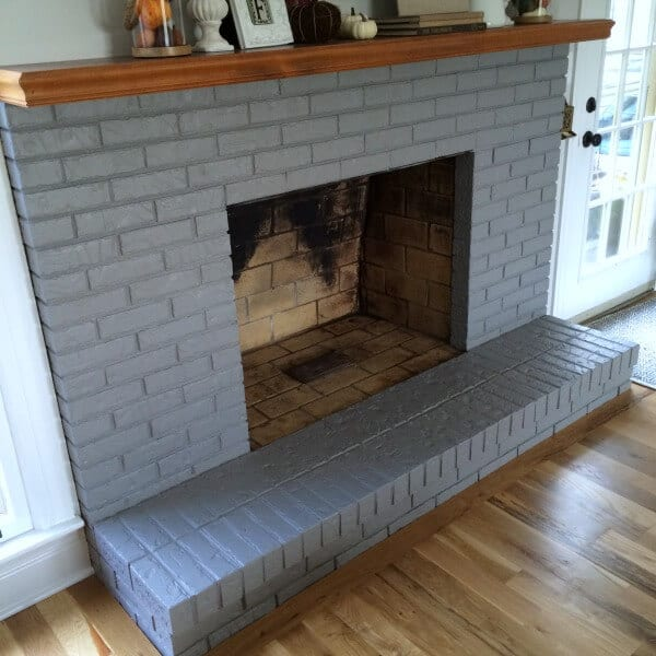 Painting a brick fireplace: How we are slowly making over our fireplace.