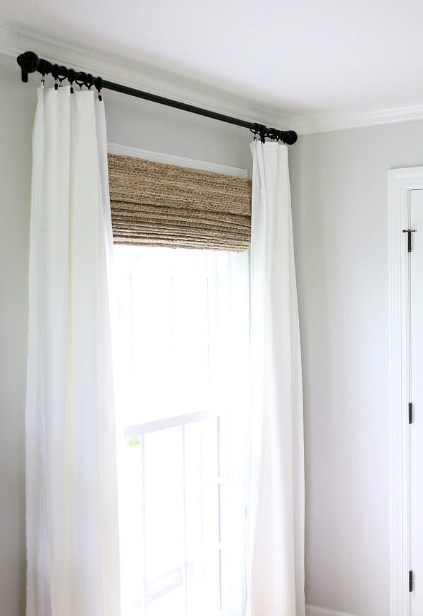 Just a little window dressing - This blogger transformed her windows with homemade curtains and Farmhouse woven shades from The Shade Store