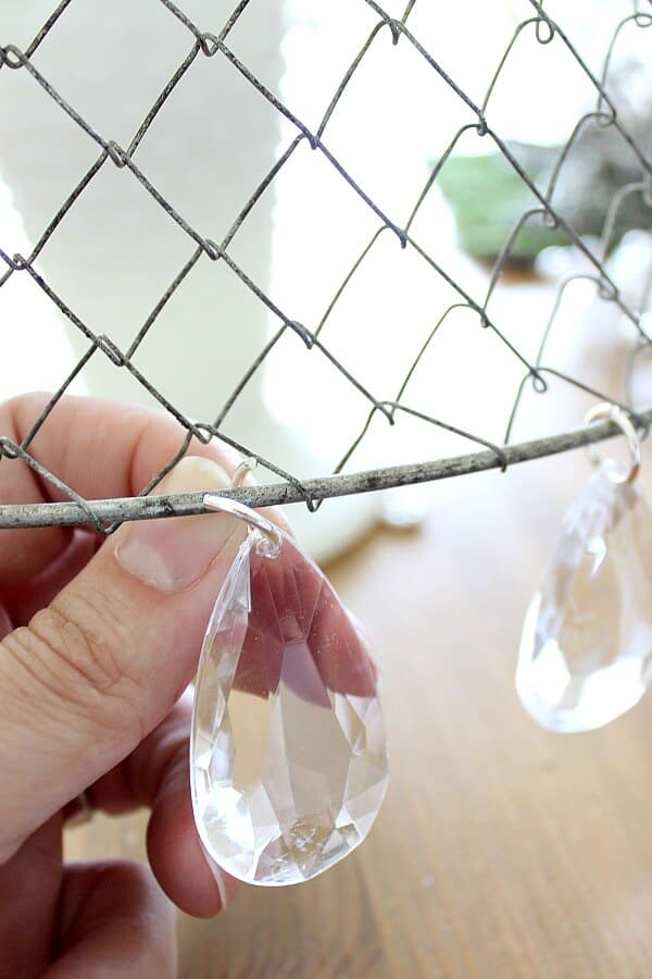 DIY Chandelier: This blogger takes an ordinary mesh basket and turns it into something stunning!