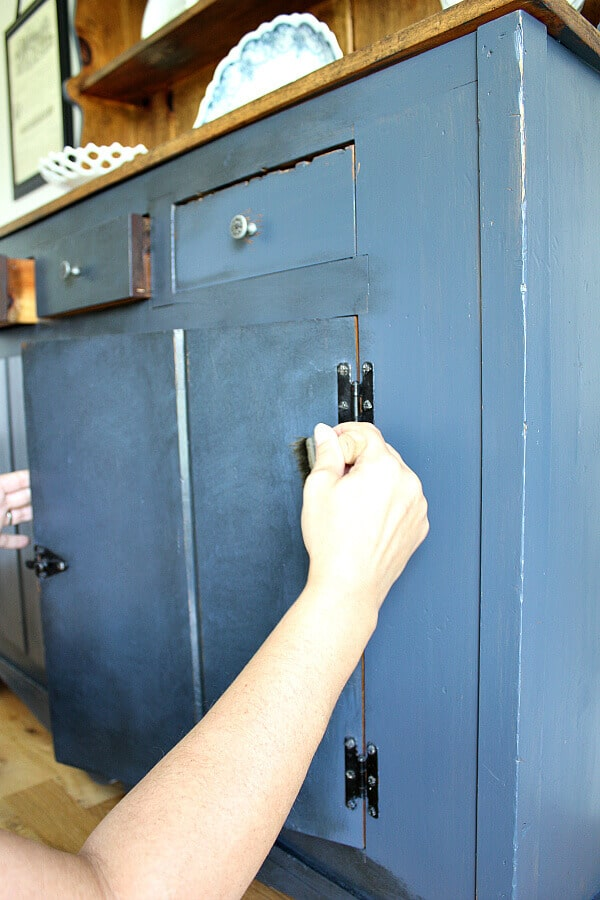 Painting Knotty Pine - Noting Grace shares how she hid her orangey hues in her pine hutch with this painting technique