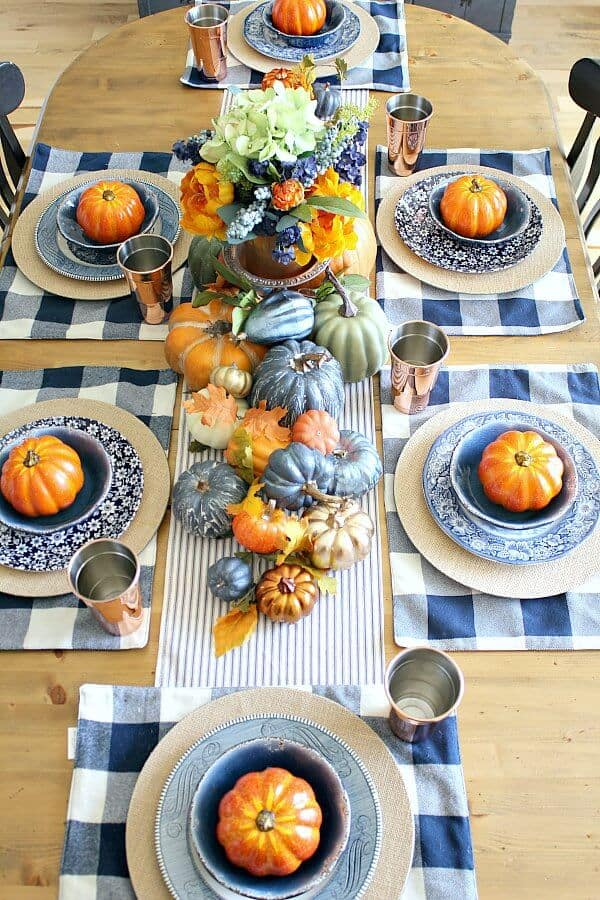 Loads of pumpkins, cozy navy hues and hints of copper complete this Copper and Navy Fall Farmhouse Tablescape