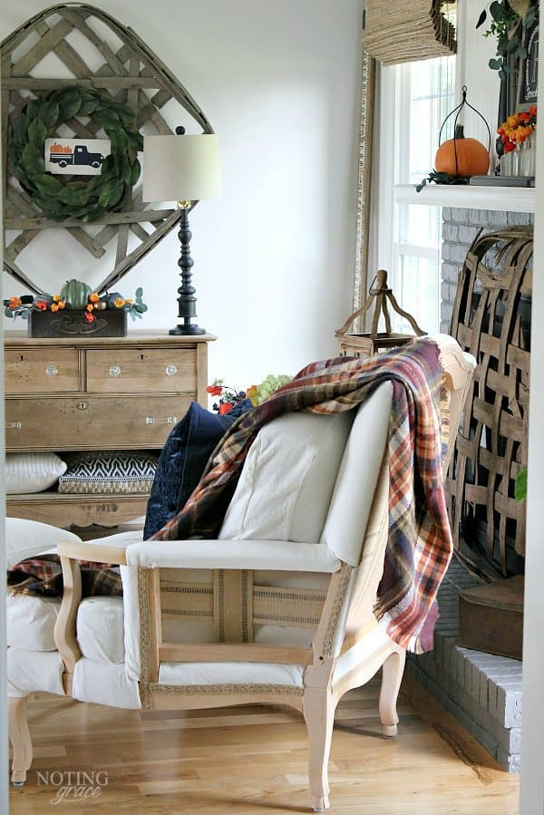 Cozy Fall Farmhouse Decor in Navy and Orange - the hottest color of the year is navy. Here's how to incorporate this cozy color in your fall decor.