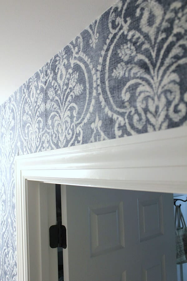 Temporary Wallpaper Tutorial: matching up the patterns makes was easy in this DIY Fabric tutorial