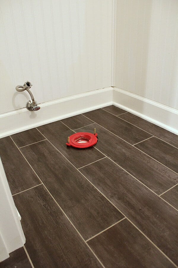 this week, we made great progress installing Luxury Vinyl tile, beadboard panels and painted the cabinet base