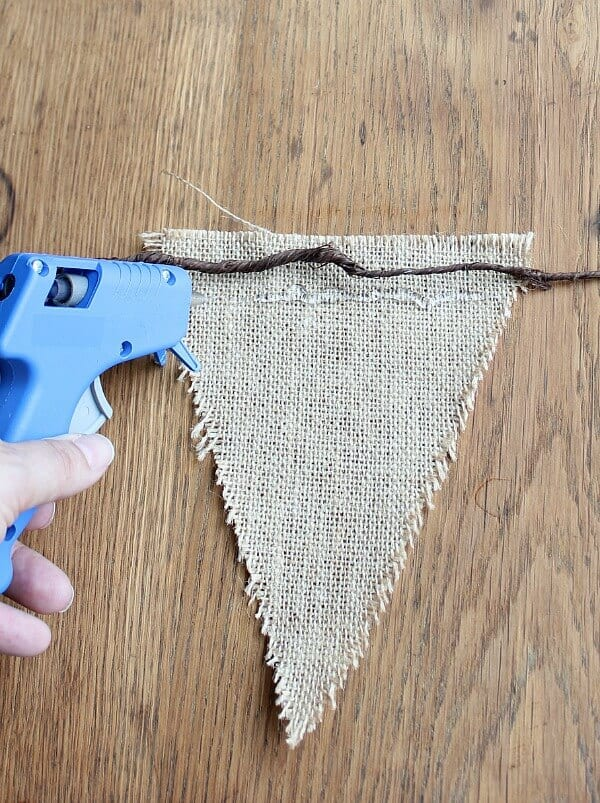 Easy Fall Bunting Tutorial: hot glue the burlap to the floral wire