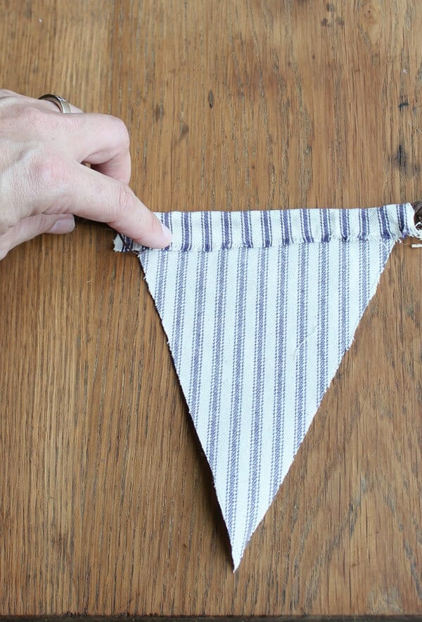 Easy Fall Bunting Tutorial: Hot glue the ticking stripe to the floral wire