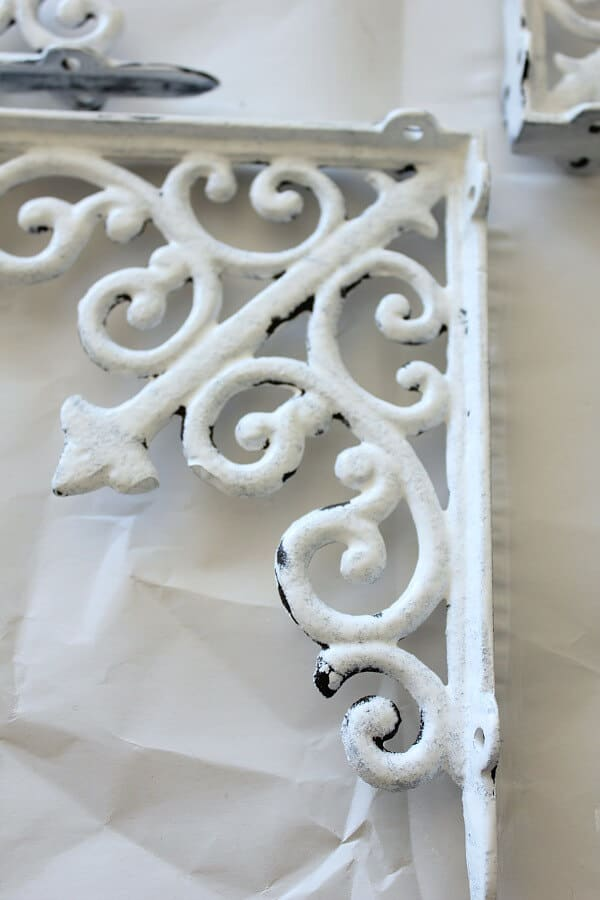 Painting Metal Shelf Brackets - Week 5 of the One Room Challenge was slow going, but we painted the bracket for the shelves over the toilet