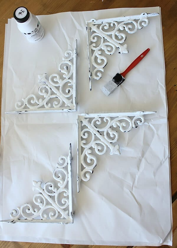 Painting Metal Shelf Brackets - we wanted a vintage, chippy look and milk paint was the solution!