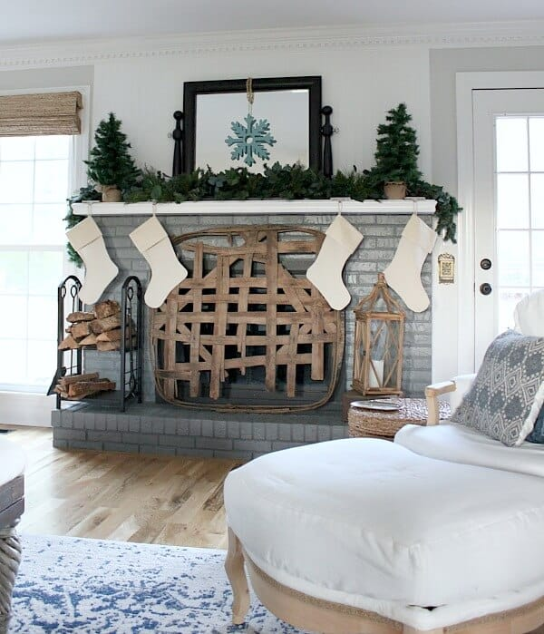 Simple Farmhouse Christmas Mantel - Creating a cozy space with farmhouse simplicity for this holiday season.