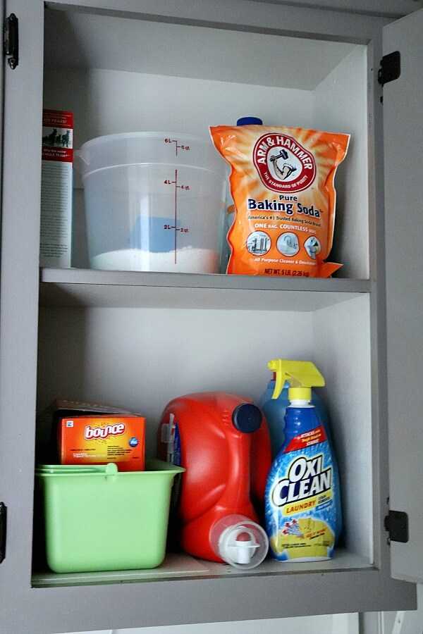 Organizing laundry and cleaning items into zones helps in controlling mudroom clutter.