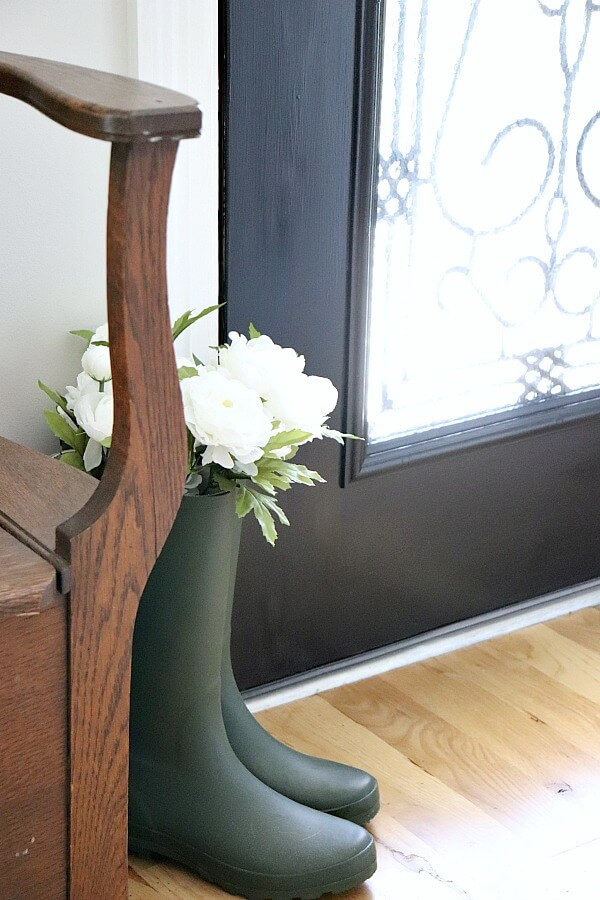Do you live with an ugly dated door? Here is how we brightened our Entryway with a DIY Glass Door Insert. It's scary to think you can cut a hole in your front door, but look at this amazing transformation!