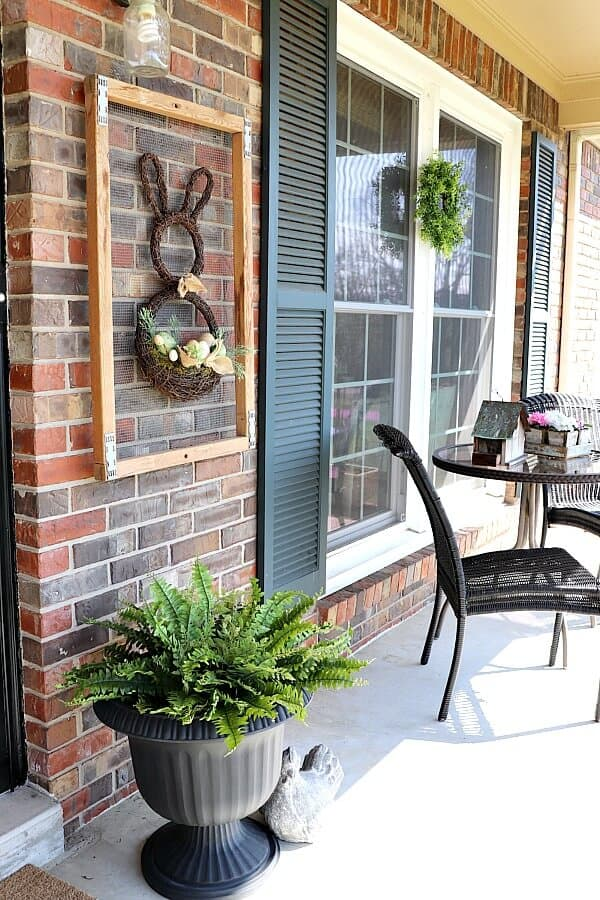 You can create a fun seasonal porch with just a few items in no time. This easy spring porch decor has transformed my wintry porch into a spot to watch the flowers bloom!