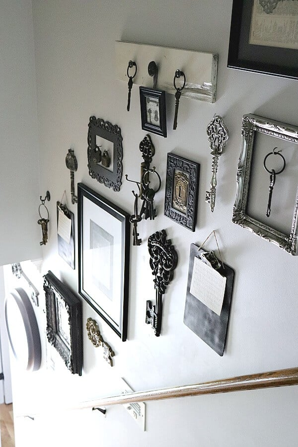 A stairway gallery wall with keys