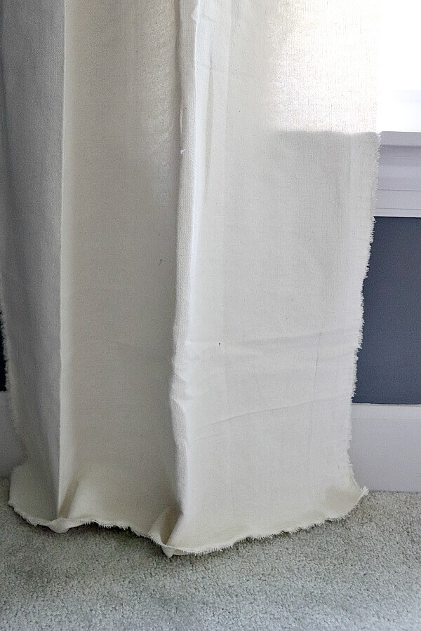 I needed a quick and budget friendly solution for window treatments in my son's room. I found my solution with these easy frayed drop cloth curtains you can make in 5 minutes.