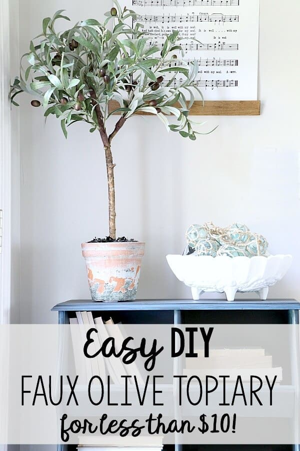 Another Ballard's Knockoff! Inspired by their latest Olive Topiary, I saved $70 by making one myself and you can too with this Easy DIY Faux Olive Topiary tutorial!