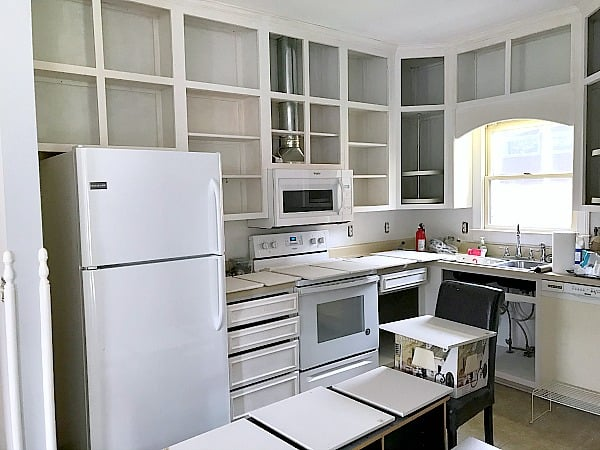 Painting Kitchen Cabinets White - we took nicotine stained cabinets from our friend's rental and made them look brand new with a coat of paint