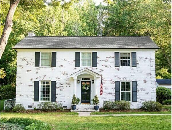 Do you hate the look of your exterior brick? We have found an easy solution and are sharing why we're limewashing our brick home