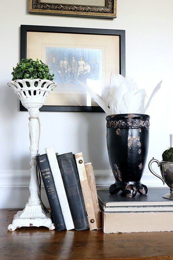 Create your own DIY rusted Cast Iron planter with this tutorial. We took an old ceramic planter and turned it into a vintage looking urn.