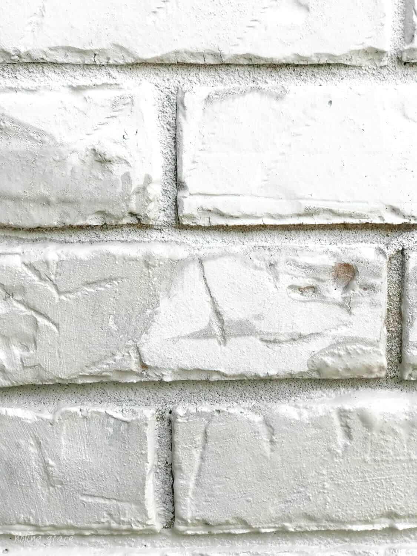 Classico Limewash in nube gray drying on brick