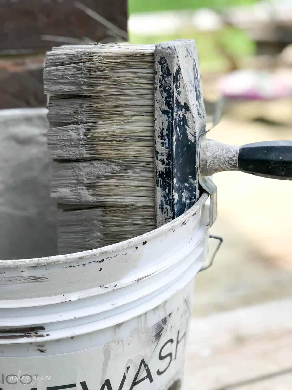 romabio masonry brush hooked onto a bucket