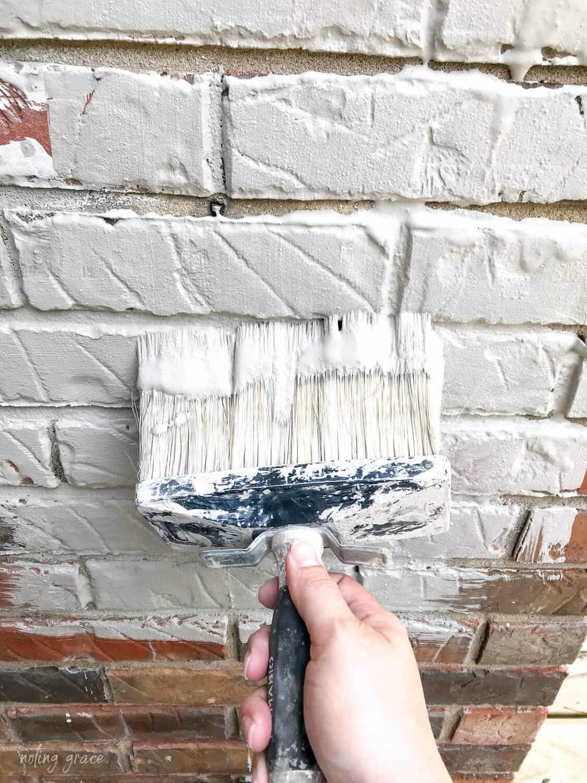 romabio masonry brush painting Classico limewash in nube gray on brick
