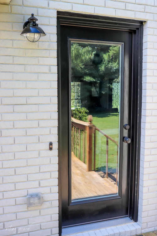 black door against Classico limewash nube gray