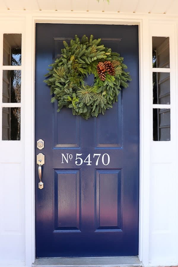 We are excited to be a part of Delaney's 12 Doors of Christmas campaign and can't wait to show you how an  Easy Front Door Refresh for Christmas is the perfect DIY to welcome all your holiday guests.