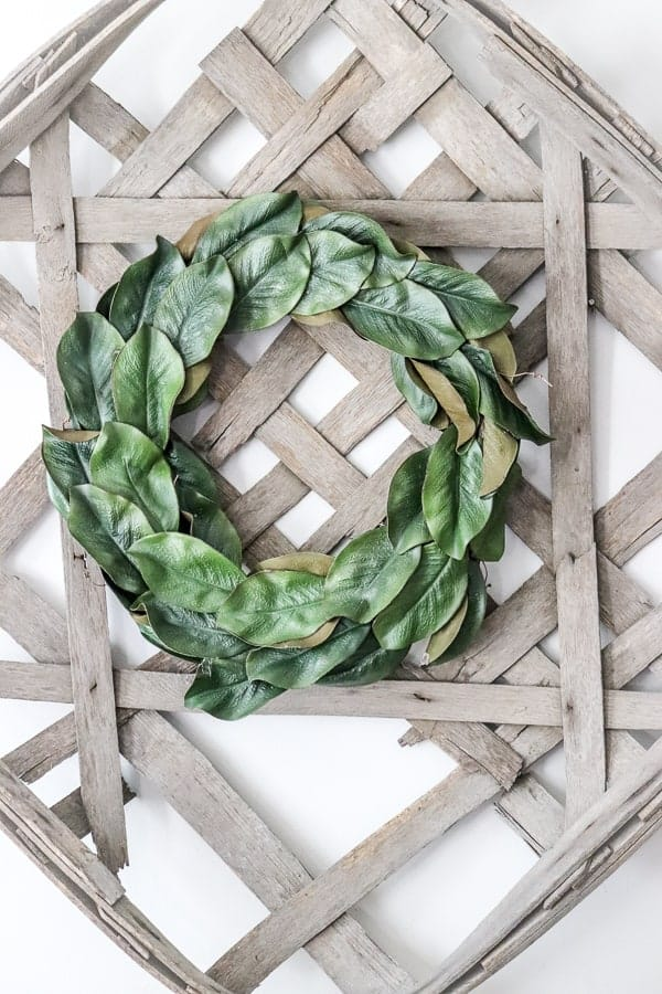 Magnolia Wreath on a Tobacco Basket - two of my favorite things to decorate with!