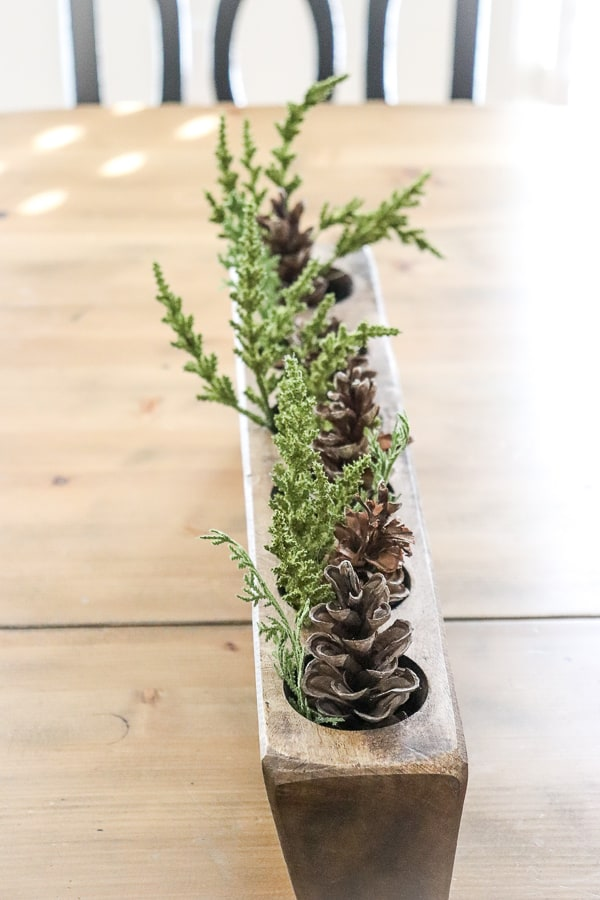 Sugar molds, pine cones, and greenery are a great way to ease into the winter season after wrapping up your Christmas.