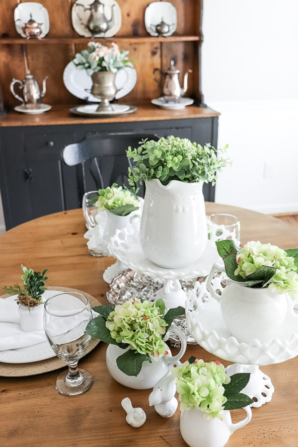 Sometimes life gets so crazy that you need to find simple solutions to home decor ideas. I shopped my home and added some faux florals for this Easy Spring Tablescape.