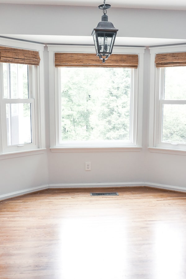 Creating Farmhouse Windows with Updated Trim and Blinds - you can update the look of your home with farmhouse flair for just a few hours and less than $200!