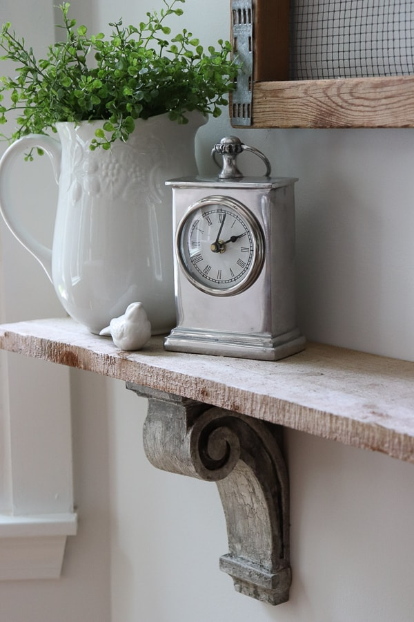 I created a quick and easy DIY shelf for my eat-in kitchen with this easy way to make new corbels look old. A simple tutorial with stunning results!