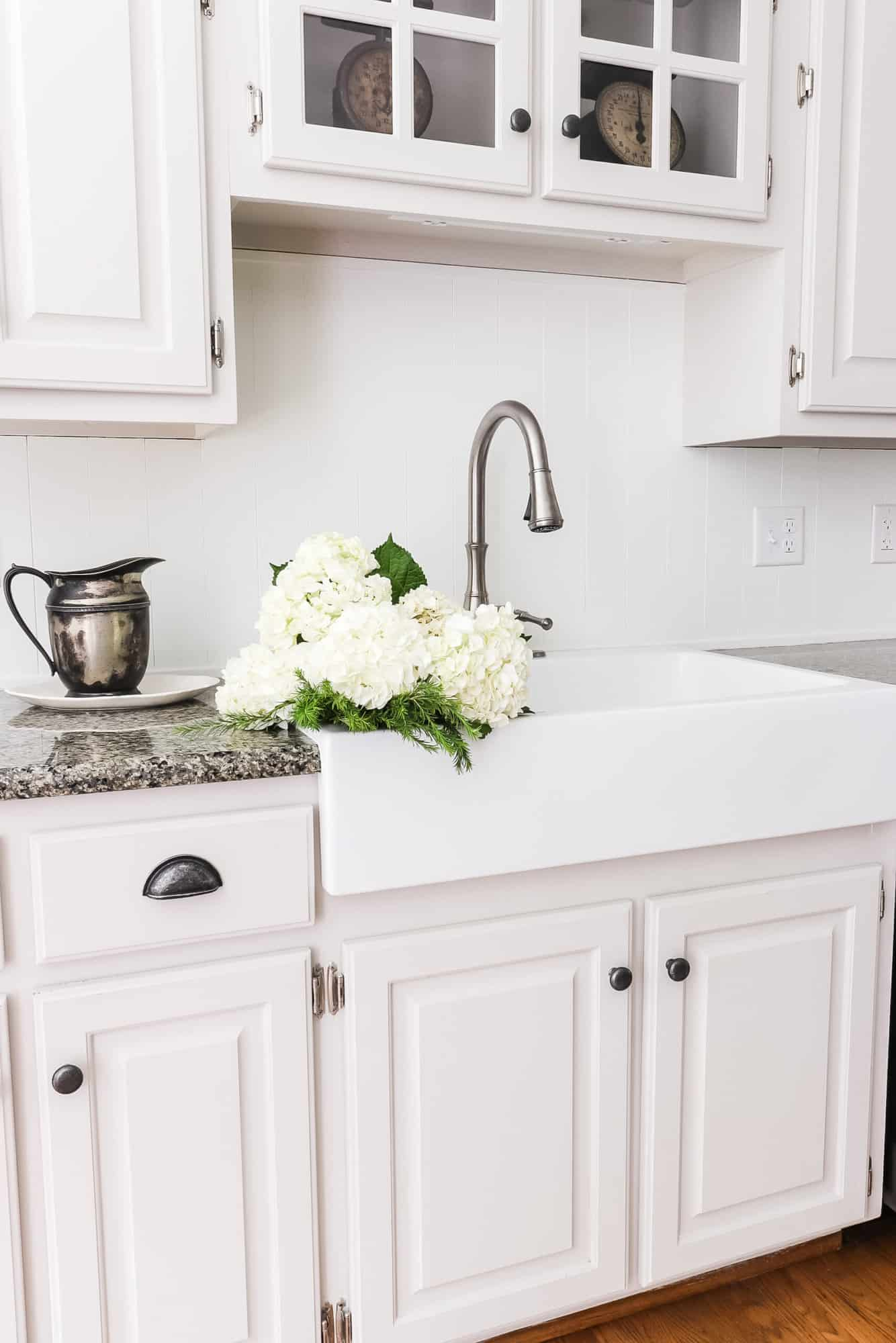Apron front sink filled with hydrangeas