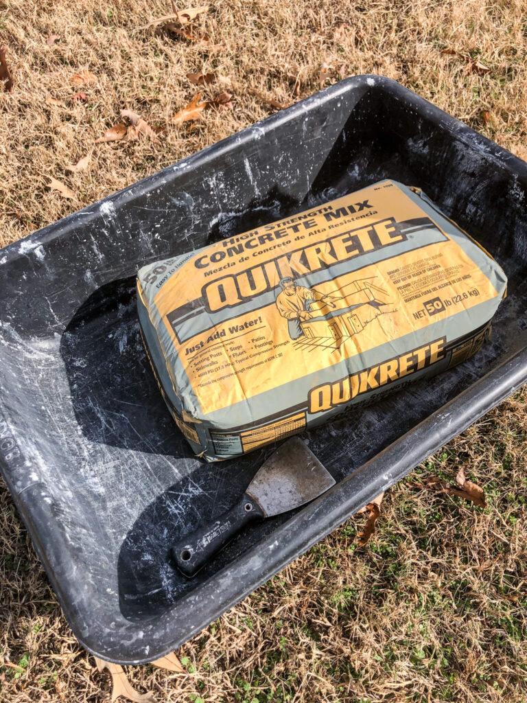 plastic concrete tub, concrete and dry wall knife