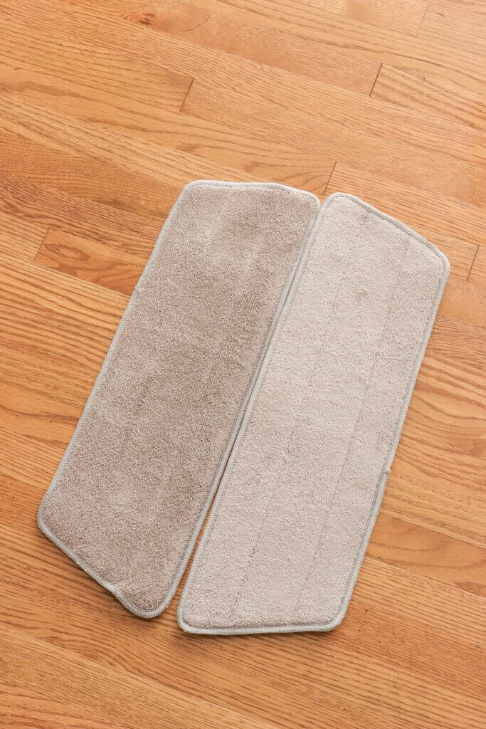 side by side of microfiber pads after second hardwood floor cleaning