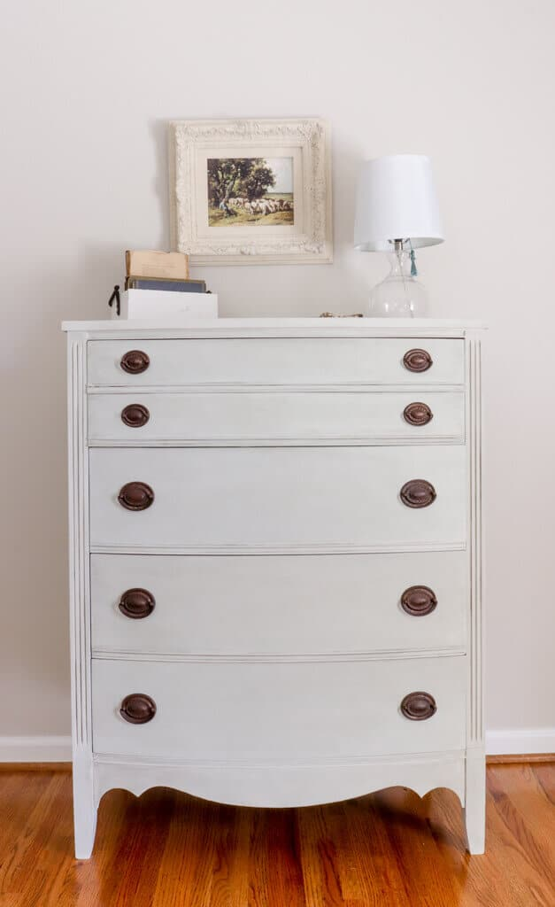 We were gifted this dresser that had seen better days. This is how we made this $15 dresser makeover with DIY chalk Paint.