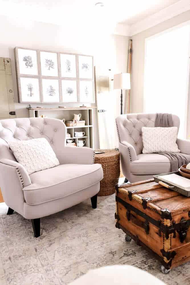 tufted accent arm chairs in a casual living room