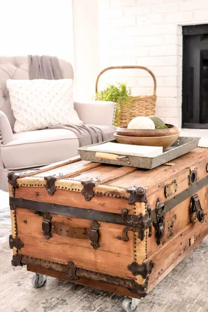 Vintage trunk with leather edges used as coffee table
