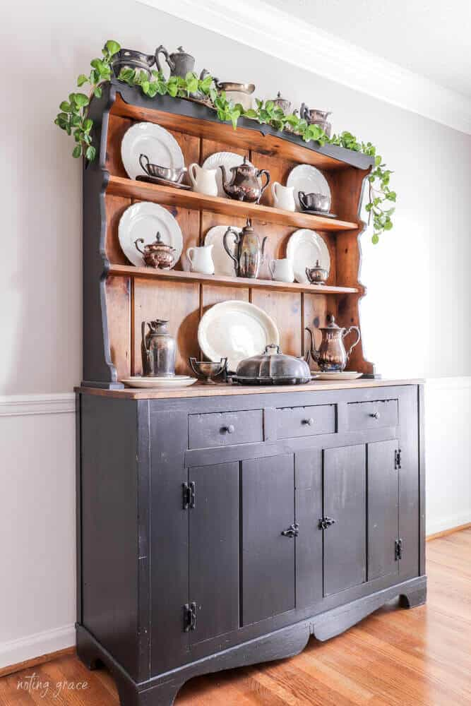 vintage hutch painted charcoal with ironstone plates, tarnished silver and spring garland