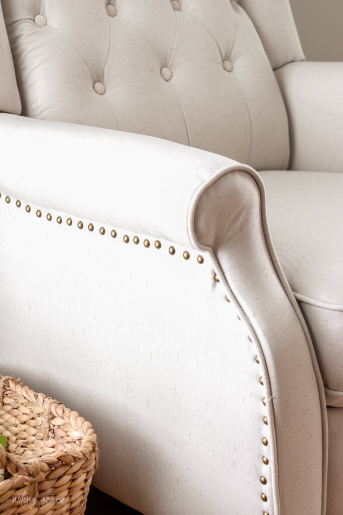close of up nail head trim on armchair