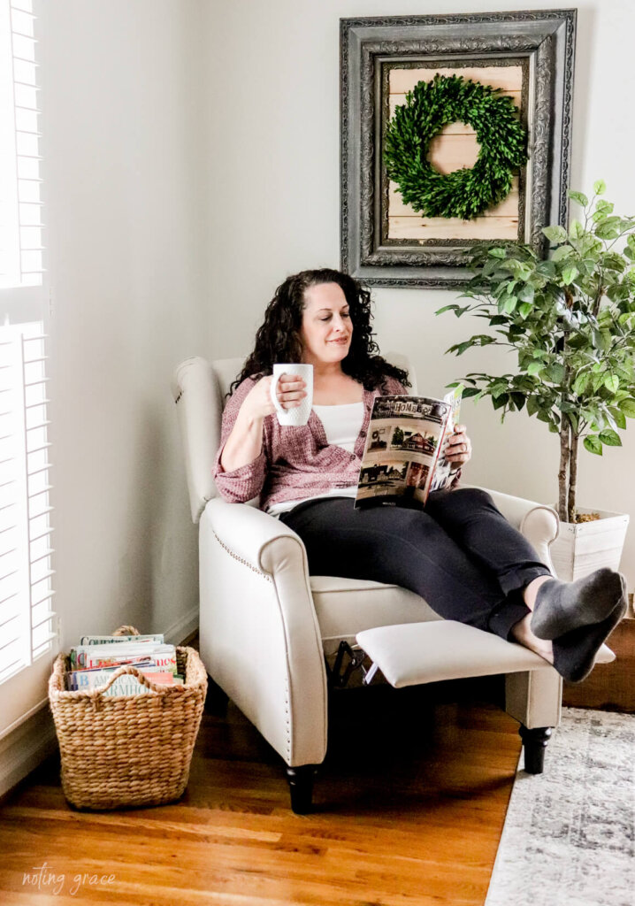 woman in recliner drinking coffee