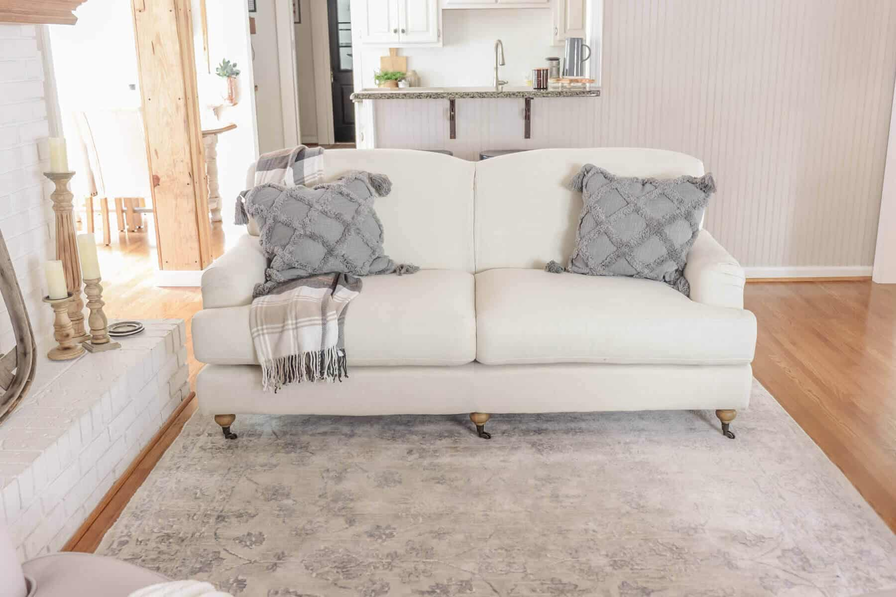curved back sofa with gray pillows