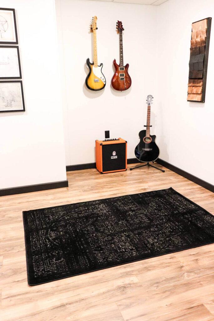 guitars hung on wall