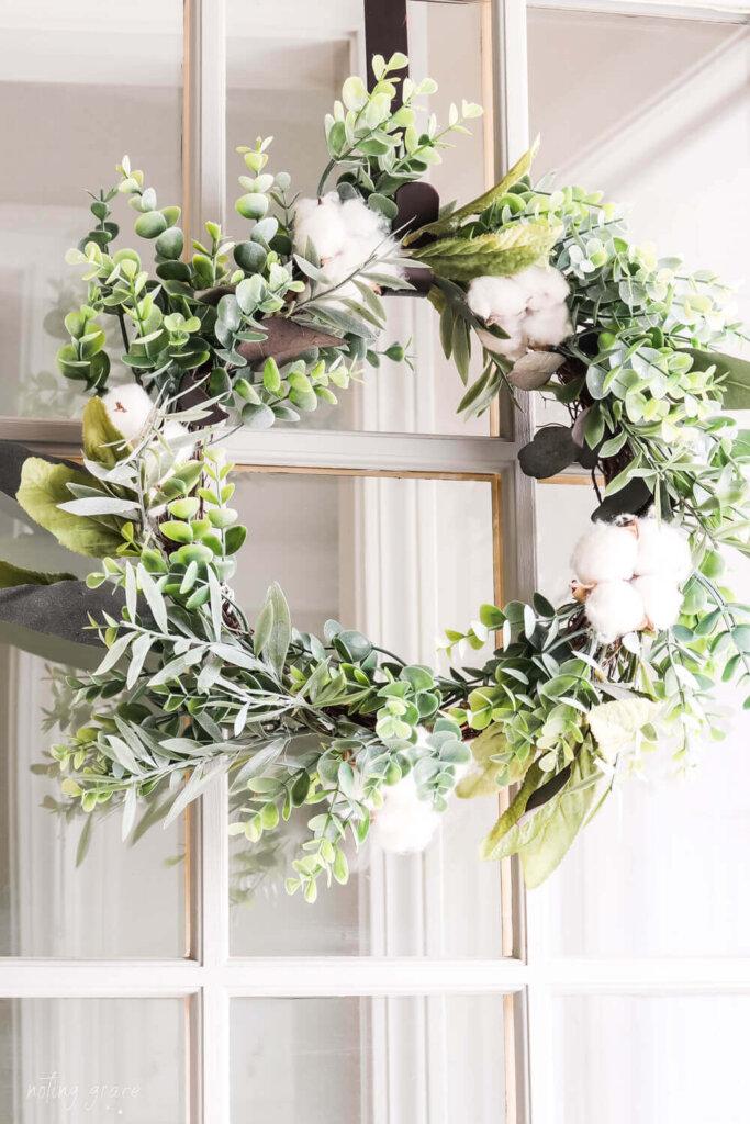eucalyptus and cotton wreath on glass front door