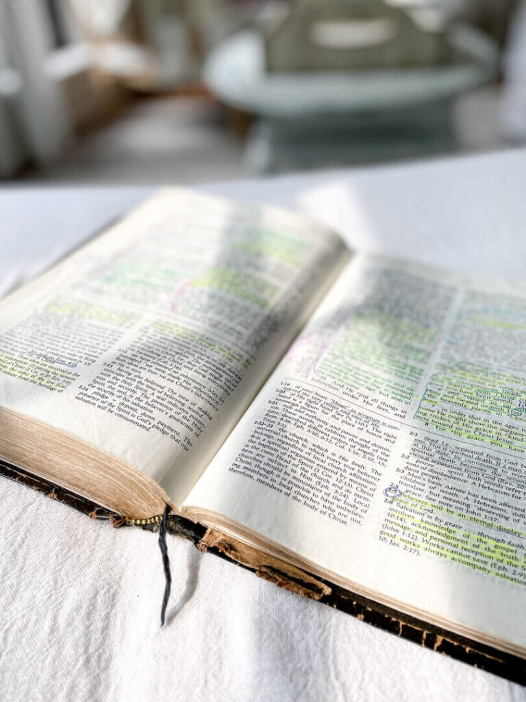 sunlight hitting bible filled with notes